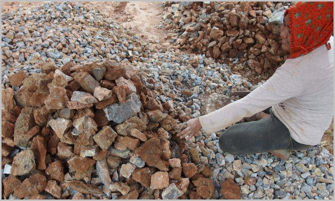 This lady uses hammer to make aggregate