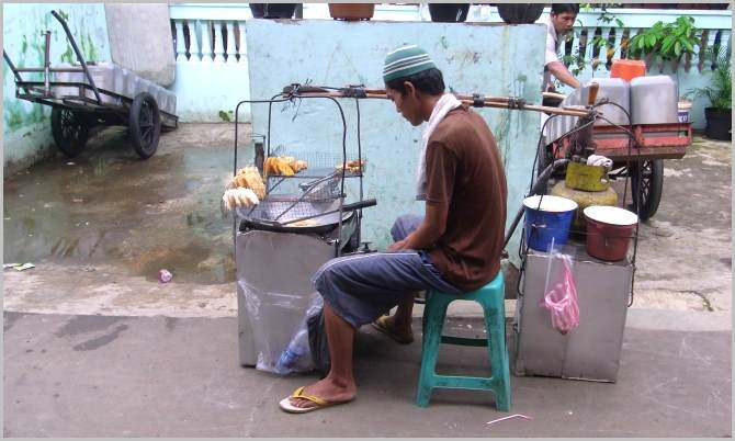 Street vendor cooking and selling fried stuff